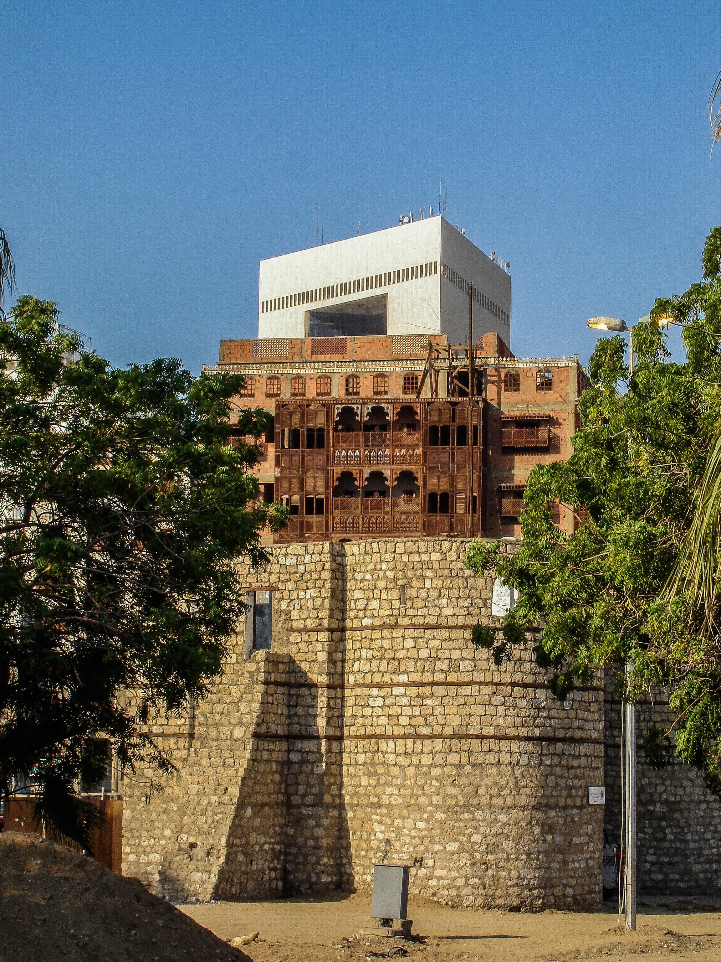 Three eras of Jeddah's history, the ancient walls, Al-Balad, and the modern city (photo: Andy Conder)