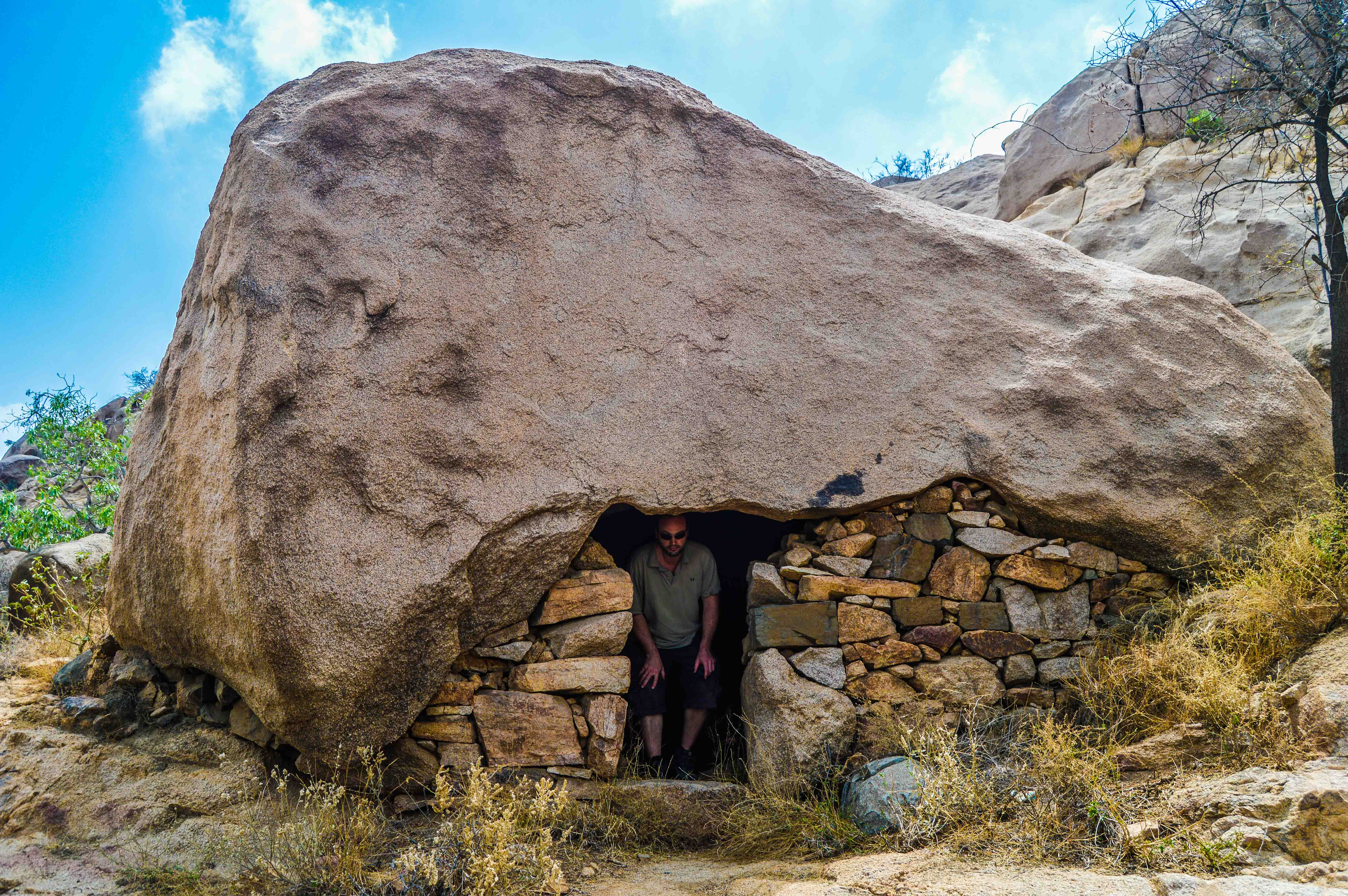 Florent Egal visiting one of the stone made house on the way to Sheda (photo: Alan Morrissey)
